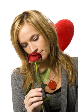 looker: Young woman with a red rose on white background Stock Photo