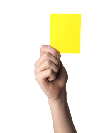 exclusion:  Hand holding up the Yellow warning card