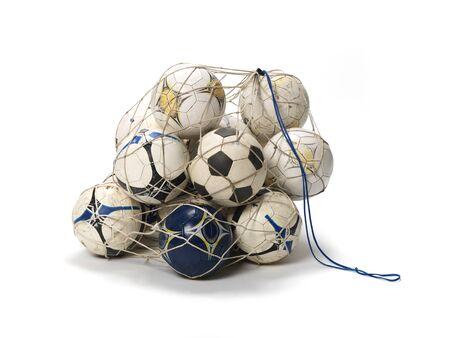 pelota de futbol: Net con balones de f�tbol en el fondo blanco Foto de archivo