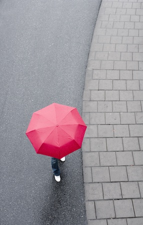 woman with umbrella: Human with red umbrella from hig Angle view