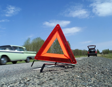 Warning traingle at the side of the road Stock Photo - 12843807