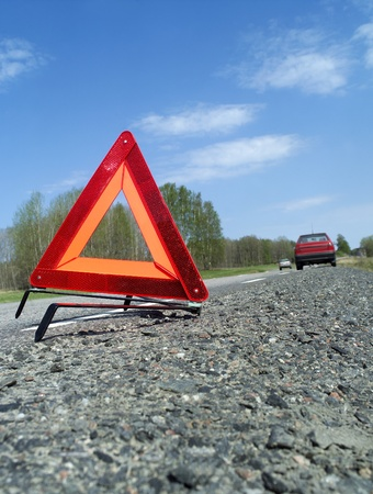 warning triangle: Warning traingle at the side of the road Stock Photo