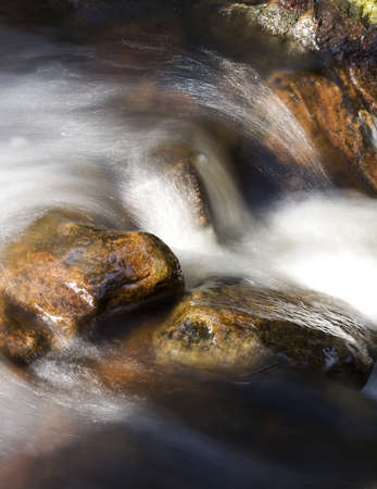 flowing water: Flowing water with selective focus Stock Photo
