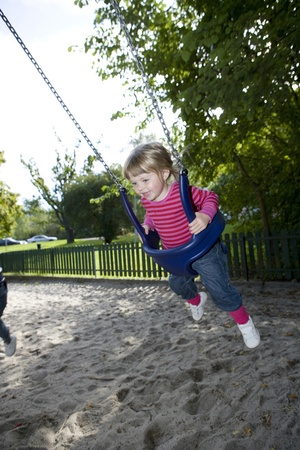 Young Happy Girl in the Swing photo