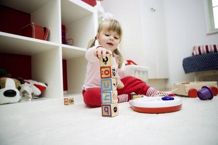 Baby girl playing in her room photo