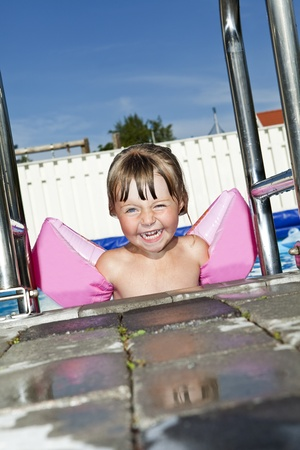 Young Happy Girl at the Swimming Pool photo