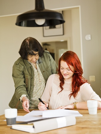 grandaughter: Grandmother helping her grandaughter with paperwork