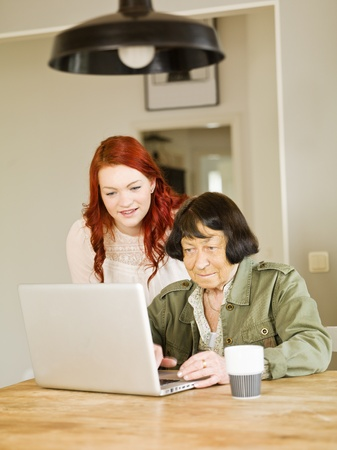 Young woman with her Grandmother by the computer Stock Photo - 12898975