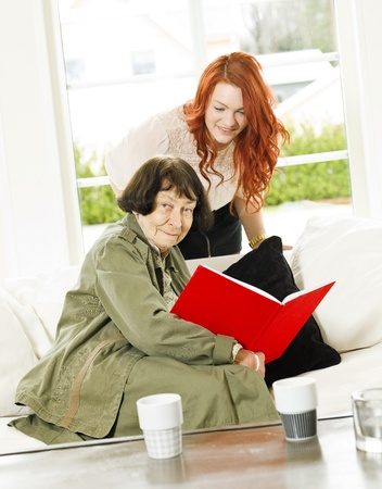 Young woman and her Grandmother looking in the Photo Album Stock Photo - 12899302