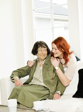 Young woman happy with her Grandmother photo