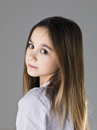 Portrait of a young girl on grey background Stock Photo - 13124984