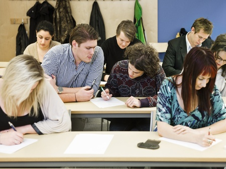 Large group of young adults studying in a classroom Stock Photo - 13125166
