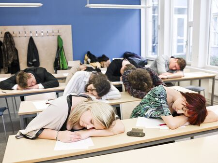 audiences: Large Group of Sleeping students Stock Photo