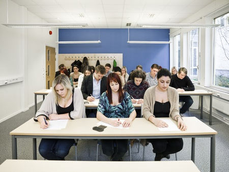 Large group of young adult students in the classroom Stock Photo - 13125172