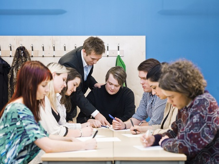 Teacher and young Adult students in the classroom photo