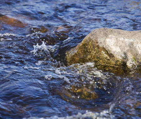 ful: Moving water on a rock Stock Photo