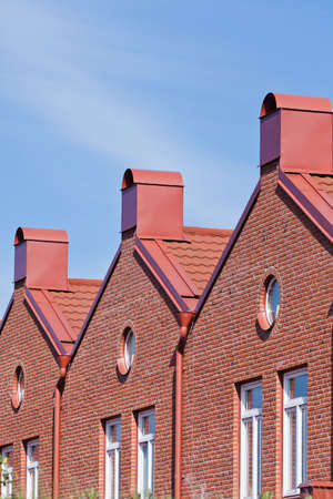 townhomes: Brick Wall building towards blue sky