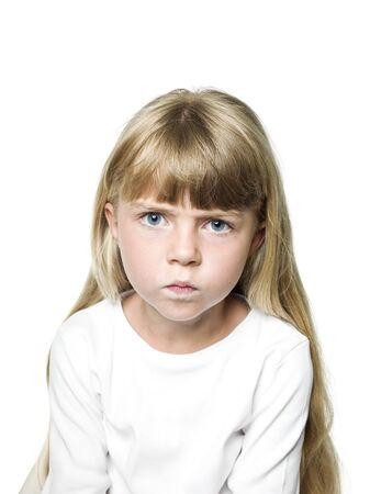 angry child: Portrait of an Angry Girl Stock Photo