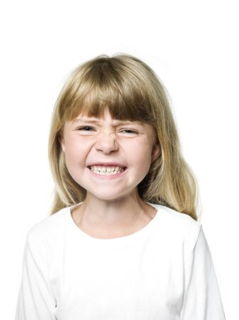 Portrait of an Angry  Girl on white background photo