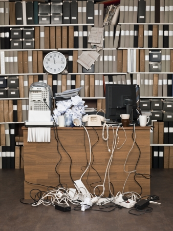 Overloaded desk at a messy office Stock Photo - 15183818