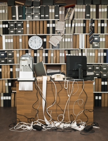 Overloaded desk at a messy office Stock Photo - 15183810