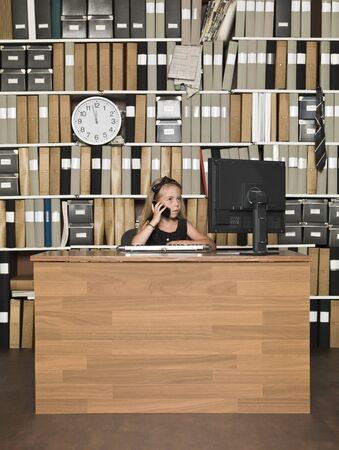 Young Business Girl on the  phone at the office Stock Photo - 14903378