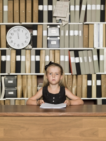 Serious young business girl at the office Stock Photo - 14903398