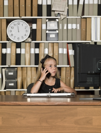 Young Buiness girl on the phone in front of a computer Stock Photo - 14903370