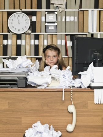 Tired Young Girl at a messy office Stock Photo - 14903391