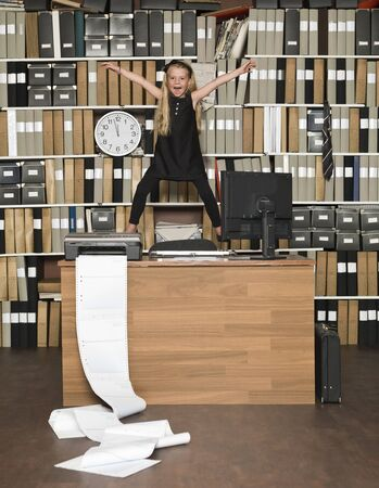 Young Happy Business Girl at the office Stock Photo - 14903416