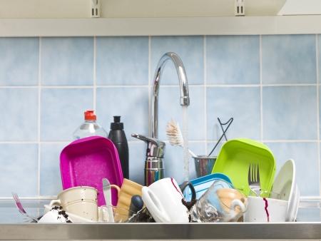 messy kitchen: Kitchen utensils need a wash Stock Photo