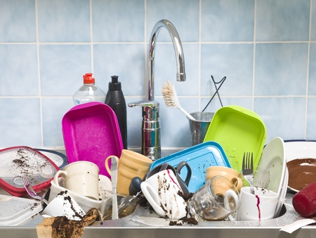 messy kitchen: Kitchen utensils need a wash Stock Photo