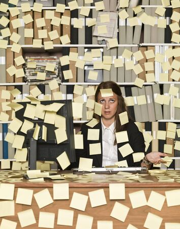 Businesswoman overloaded with reminding notes photo