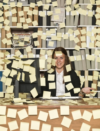 reminding: Businesswoman overloaded with reminding notes Stock Photo