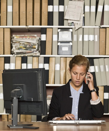 Businesswoman on the phone at the office Stock Photo - 14903421