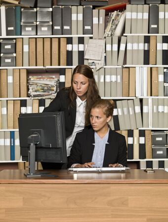 Two businesswomen in front of a computer Stock Photo - 14903429