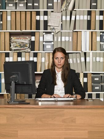 Serious Businesswoman at the office Stock Photo - 14903428