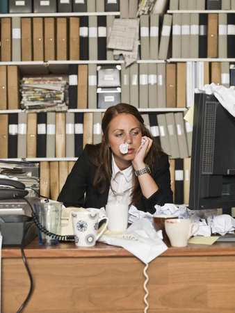 Businesswoman with the flu at the office Stock Photo - 14903430