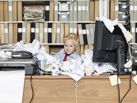Young business man in a messy office Stock Photo - 14962348
