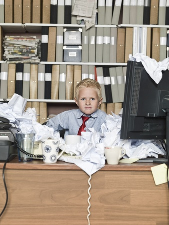 Young business man in a messy office photo
