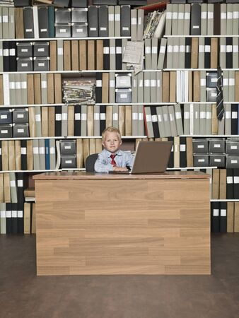 Young Businessman with computer at the office photo
