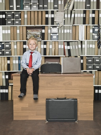 Young Businessman sitting on the table at the office photo