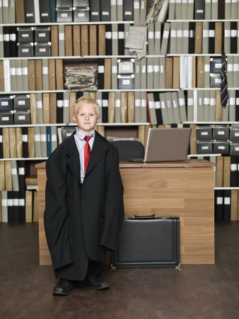 working dress: Young Businessman wearing oversized clothes in the office Stock Photo