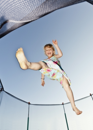 trampoline: Young Girl Jumping in a trampoline