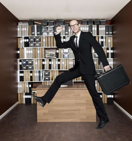 Jumping businessman in the office Stock Photo - 16009228