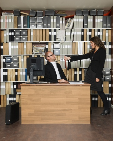 Female boss with male employer at the office Stock Photo - 16009237
