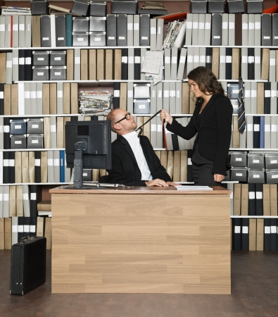 Female boss with male employer at the office Stock Photo - 16009224