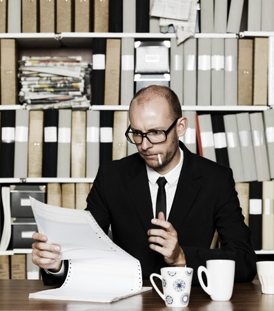 Businessman with cigarette at the office Stock Photo - 16009230