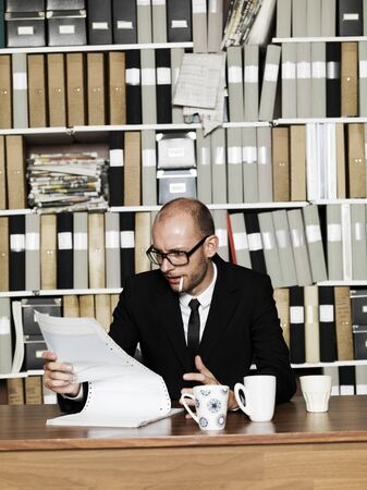 Businessman with cigarette at the office photo
