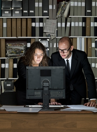 Business couple at the office at night Stock Photo - 16009233